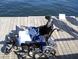 Empty wheelchair on the pier in the harbor